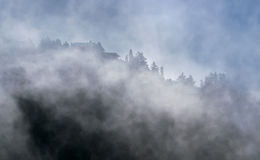 Raising fog. From the valley in early morning Stock Photography