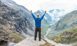 Raising Hands on the edge of a mountain in Himalaya Mountain Range stock photos