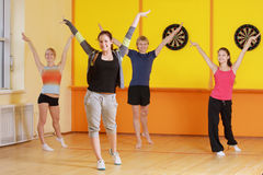 Raising hands in group aerobics Stock Image