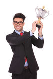 Raising his trophy & smiling Royalty Free Stock Photography