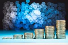 Raising stack of coins Stock Photos