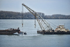 Raising Sunken Ship from Danube royalty free stock images