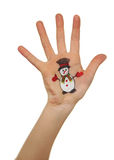 Raising up child hand with painted Christmas symbol Stock Photos