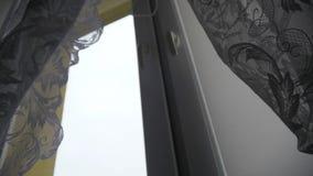 Raising the Window Shades stock footage