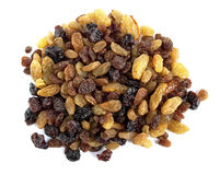 Raisins. Pile of assorted raisins isolated over a white background stock image