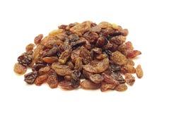 Raisins. A pile of raisins isolated on the white background Stock Photo