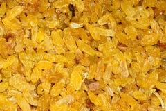 Raisins. The background of yellow raisins Royalty Free Stock Photo