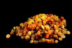 Raisins. Image of golden raisins isolated on black background Royalty Free Stock Image