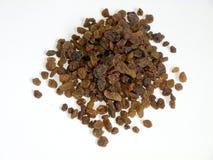 Raisins. Brown raisins on white background Royalty Free Stock Photography