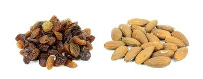 Raisins and almonds on a white background Stock Photos