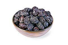 Raisins black in bowl Stock Photos