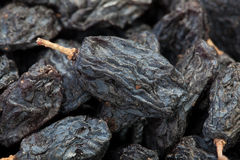 Raisins black many macro Royalty Free Stock Photography