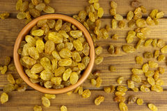 Raisins  in bowl over wooden background Stock Images