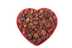 Raisins in a bowl in the shape of a heart Royalty Free Stock Photos