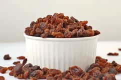 Raisins on the bowl the white background. Raisens in the bowl on the white background, overhead horizontal view Royalty Free Stock Images