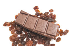Raisins and chocolate. Bar closeup on white background Royalty Free Stock Photos