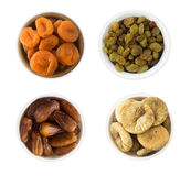 Raisins, dates, dried apricot, figs isolated on white background. Top view. Stock Photo