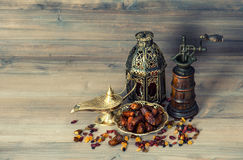 Raisins and dates. Vintage oriental lantern and mill Royalty Free Stock Photography