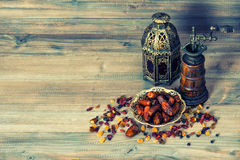 Raisins and dates. Vintage oriental lantern. Retro style toned Stock Image