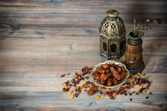 Raisins and dates. Vintage oriental latern and mill Royalty Free Stock Photography