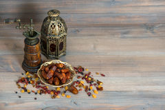 Raisins and dates. Vintage oriental latern and mill Stock Photography