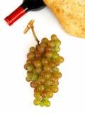 Raisins de muscat, bouteille de vin et pain Photos stock