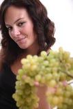 Raisins de offre de fille Image stock