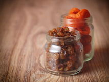 Raisins dried apricots. In a glass jar Royalty Free Stock Photo