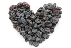 Raisins - dried fruits in the form of heart. Raisins laid out in the form of heart Royalty Free Stock Photo