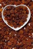 Raisins, dried grape. Raisins,dried grape ine heart shaped tray Stock Images