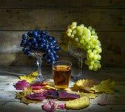 Raisins et jus de raisins Photographie stock
