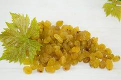 Raisins on the grape leaf Stock Images