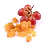 Raisins with grapes Royalty Free Stock Photos