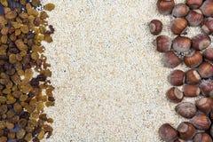 Raisins, hazelnuts and sesame Royalty Free Stock Photography