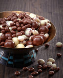 Raisins and nuts covered with chocolate Stock Photography