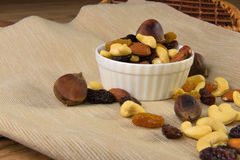 Raisins and nuts in a saucer on the background of canvas Stock Image