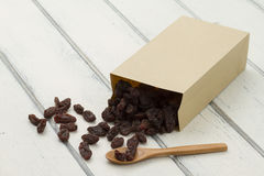 Raisins in a paper bag Royalty Free Stock Photography