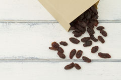 Raisins in a paper bag Royalty Free Stock Photo