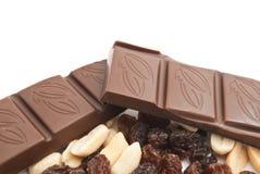 Raisins, peanuts and chocolate bar. On white Stock Photo