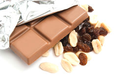 Raisins, peanuts and chocolate bar on white. Raisins, peanuts and chocolate bar closeup on white Stock Photography