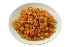 Raisins on a plate Stock Photography