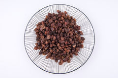 Raisins on the plate Royalty Free Stock Image