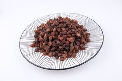 Raisins on the plate Royalty Free Stock Photography