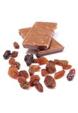 Raisins and portion of chocolate Stock Images