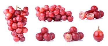 Raisins rouges d'isolement sur un fond blanc Photos libres de droits