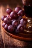 Raisins rouges et vin Photos stock