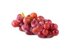 Raisins rouges frais d'isolement sur le fond blanc Photographie stock libre de droits
