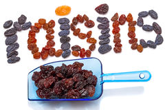 Raisins in the scoop and the word Stock Photo