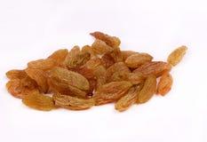 Raisins secs d'isolement sur le blanc Photos stock