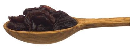 Raisins secs dans une cuillère en bois Photographie stock